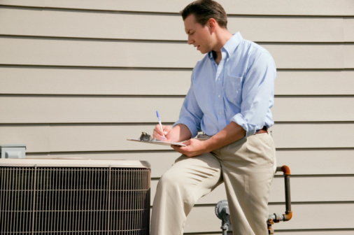 Man checking on HVAC equipment