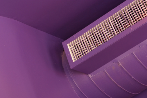 Air conditioner on purple walls